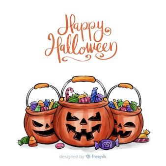 Fondo de halloween en acuarela con calabazas y caramelos