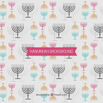 Fondo de hanukkah con candelabros en diferentes colores