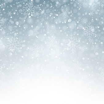 Fondo invernal plateado con copos de nieve