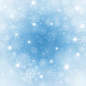 Fondo de invierno azul con copos de nieve.