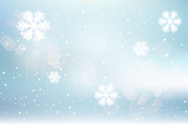 Fondo de invierno borroso con copos de nieve
