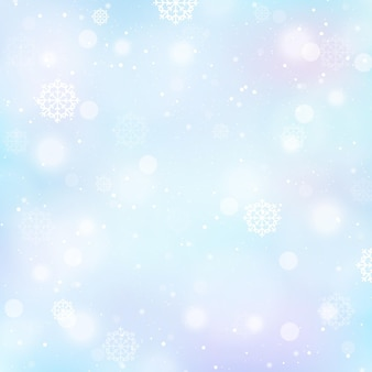 Fondo de invierno desenfocado con copos de nieve