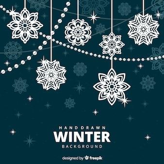 Fondo de invierno elegante con copos de nieve