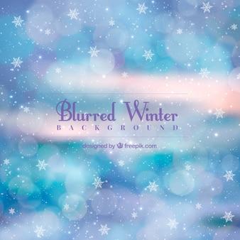 Fondo de invierno fantástico con copos de nieve y efecto bokeh