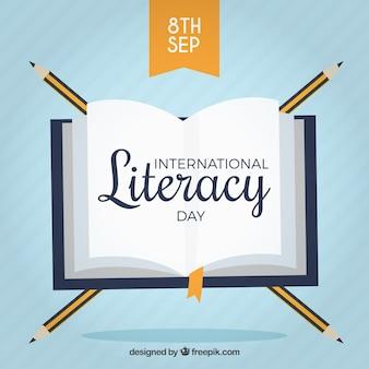Fondo de libro con lápices para el día de la alfabetización