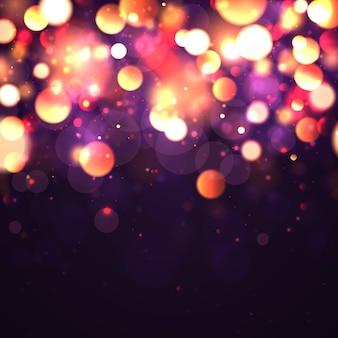 Fondo luminoso festivo púrpura y dorado con luces de colores bokeh.