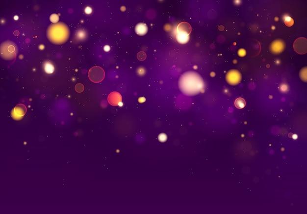 Fondo luminoso púrpura y dorado con luces bokeh.