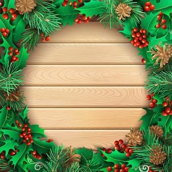Fondo de madera clara de navidad con bayas de acebo, ramas de pino y conos