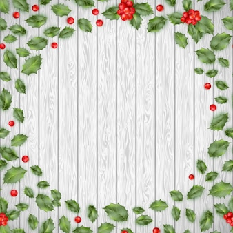 Fondo de madera de navidad con bayas rojas de acebo. y también incluye