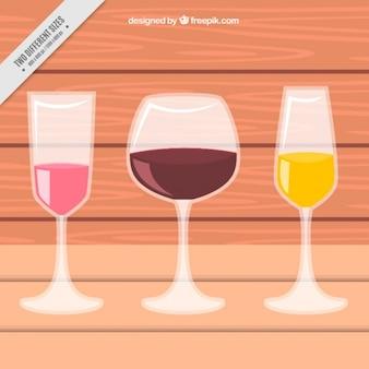 Fondo de madera con tres copas de vino