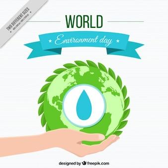 Fondo de mano con un mundo ecológico