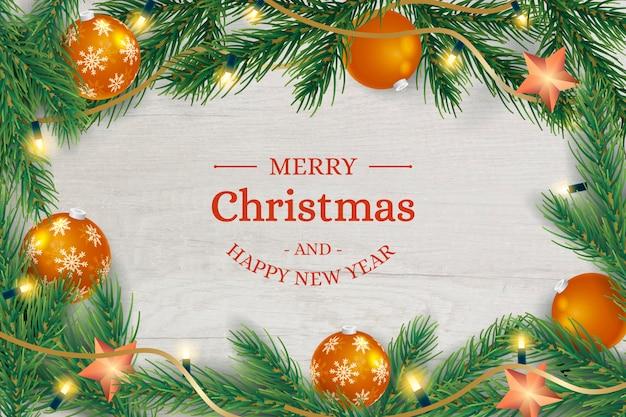 Fondo de marco de madera de navidad con bolas y ramas de los árboles