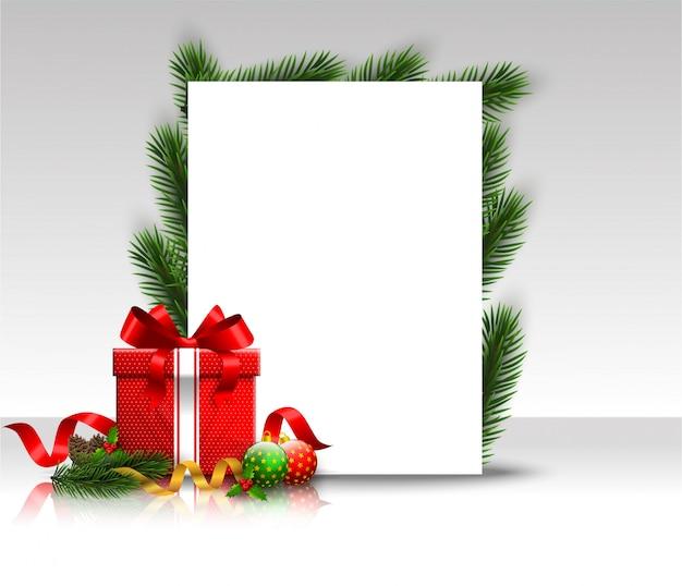 Fondo de marco de navidad con ramas de abeto y bolas rojas. hoja de papel en arco de regalo.