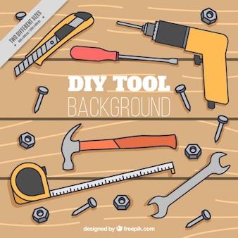 Fondo de mesa de madera con herramientas dibujadas a mano