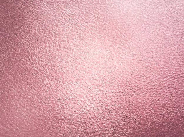 Fondo metálico de oro rosa con textura de brillo.