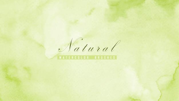 Fondo natural abstracto diseñado con manchas de acuarela verde.