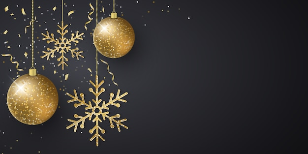 Fondo de navidad con adornos de bolas brillantes colgantes, copos de nieve, confeti volador y oropel sobre un fondo oscuro.