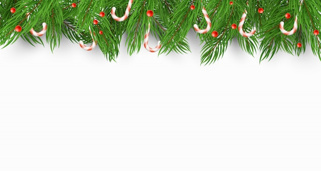 Fondo de navidad con un árbol de navidad, caramelos y bayas de nieve.