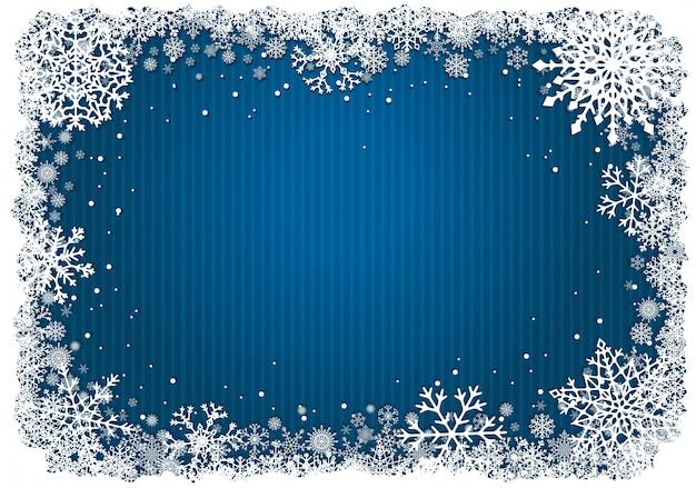 Fondo de navidad azul con marco de copos de nieve