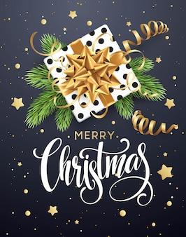 Fondo de navidad con caja de regalo con lazo de oro.