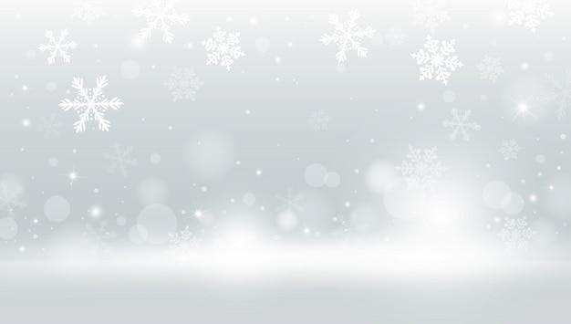 Fondo de navidad de copo de nieve y nieve cayendo con bokeh