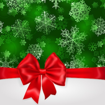 Fondo de navidad con copos de nieve en colores verdes y gran lazo rojo con cintas horizontales