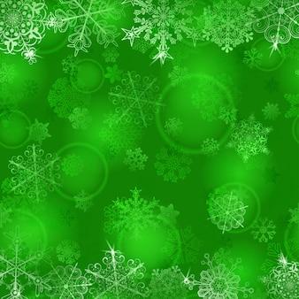 Fondo de navidad con copos de nieve en colores verdes.