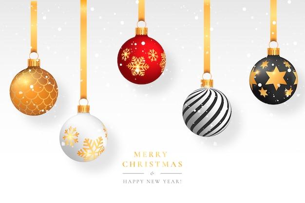 Fondo de navidad cubierto de nieve con bolas elegantes