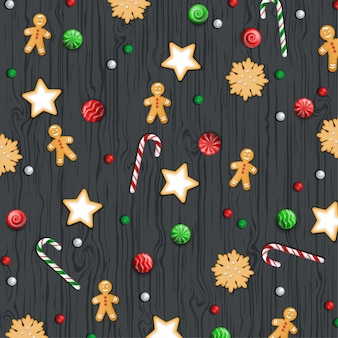 Fondo de navidad, dulces en una mesa de madera negra.