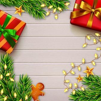 Fondo de navidad con espacio de copia. mesa de madera con regalos. vista superior.