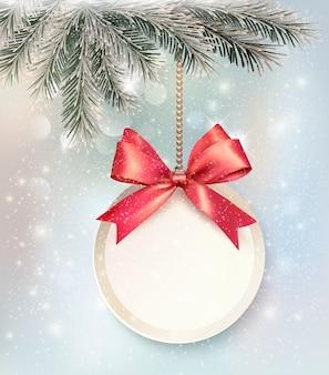 Fondo de navidad con una etiqueta y un lazo.
