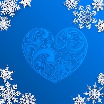 Fondo de navidad con gran corazón y copos de nieve sobre fondo azul.