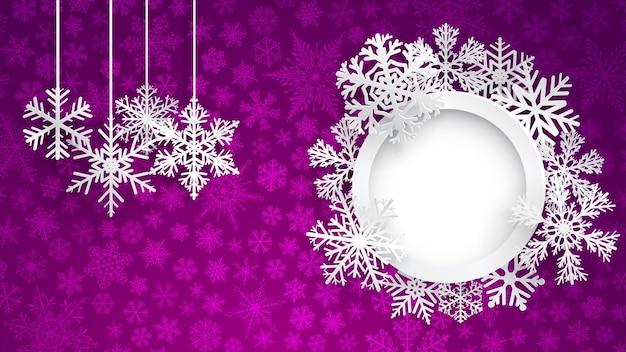 Fondo de navidad con marco redondo rodeado de copos de nieve y varios copos de nieve colgantes sobre fondo violeta de pequeños copos de nieve. ilustración navideña con copos de nieve y marco de fotos redondo