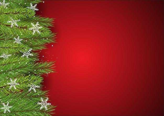 Fondo de navidad con ramas de pino y copos de nieve
