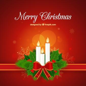 Fondo de navidad con tres velas blancas decoradas