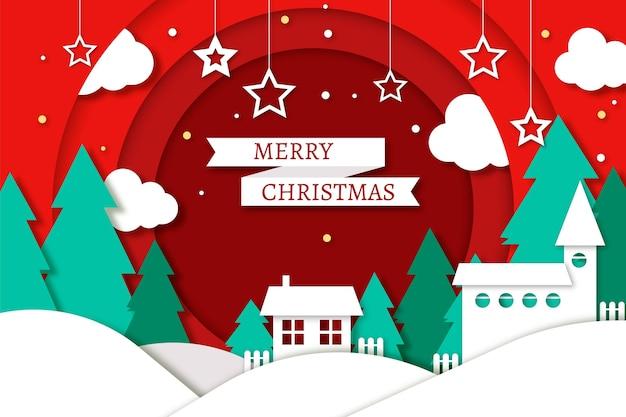 Fondo navideño en estilo papel con casas y pinos.
