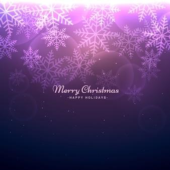 Fondo navideño morado bokeh con copos de nieve