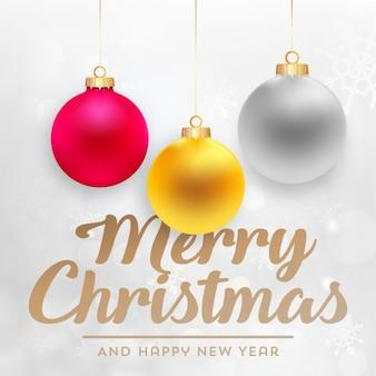 Fondo navideño con tres bolas de navidad de colores