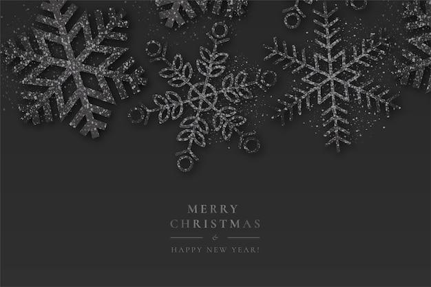 Fondo negro de navidad con copos de nieve brillantes