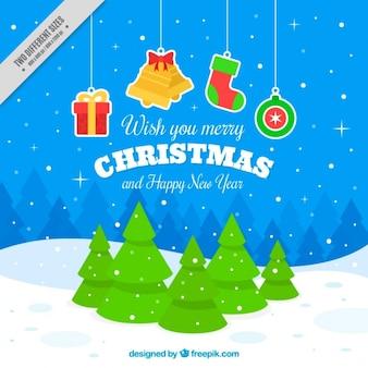 Fondo nevado con árboles y pegatinas de navidad