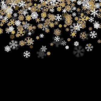 Fondo de nieve con copos de nieve doradas borrosas en la oscuridad