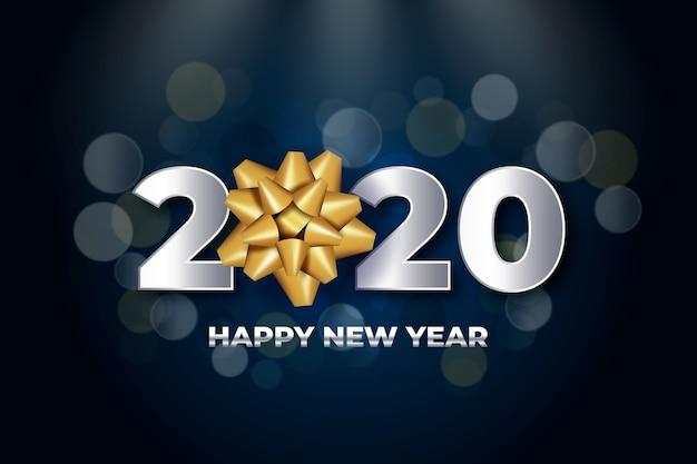 Fondo con números de año nuevo y arco de regalo