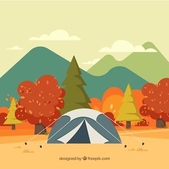 Fondo de otoño con árboles y tienda de campaña