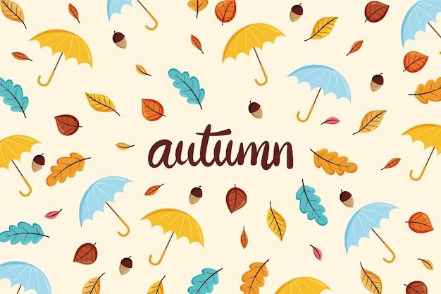 Fondo otoño dibujado a mano con hojas y sombrillas