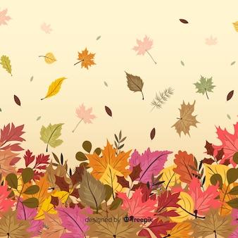 Fondo de otoño con hojas dibujado a mano