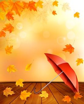 Fondo de otoño retro con hojas de colores y un paraguas.