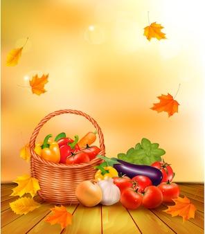 Fondo de otoño con verduras frescas en la canasta