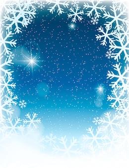Fondo de paisaje de invierno desenfocado con copos de nieve