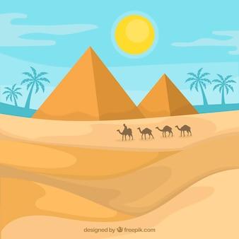 Fondo de paisaje de pirámides de egipto con caravana de camellos