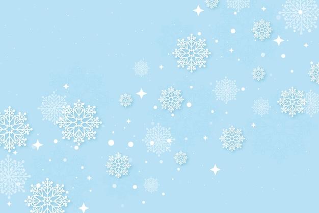 Fondo de pantalla de invierno en estilo papel con copos de nieve